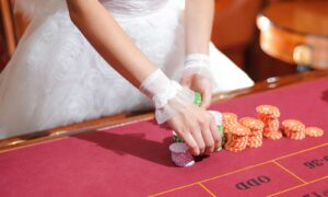 How to organize an epic casino themed wedding bride at roulette table 1